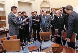 United States President George H.W. Bush receives a birthday gift from White House Chief of Staff John Sununu and other members of his senior staff including Richard Darman, Director of the Office of Management and Budget; US Air Force General Brent Scowcroft, National Security Advisor; White House Deputy Chief of Staff Andy Card; White House Counsel C. Boyden Gray; and other members of the President's Senior Staff in the Oval Office of the White House in Washington, DC, USA, on July 12, 1990. Photo by David Valdez / White House via CNP/ABACAPRESS.COM