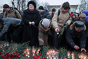 Moscow, Russia, 27/01/2011..Mourners lay flowers at a memorial ceremony in central Moscow for the 35 people killed in the Domodedovo airport bombing.