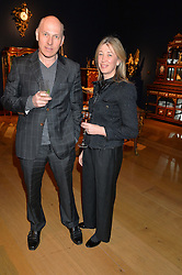 PEREGRINE & CAROLINE ARMSTRONG-JONES at a party to celebrate the publication of Interiors For Living by Joanna Wood held at Christie's. 8 King Street, St.James's, London on 2nd March 2015.