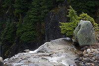The waters of Edith Creek flow over the edge of Myrtle Falls into the darkness at Paradise in Mount Rainier National Park, WA, USA.