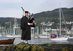 The Silvers Marine Scottish Series 2014, organised by the  Clyde Cruising Club,  celebrates it's 40th anniversary.<br /> <br /> Piper at the entrance to Tarbert Harbour<br /> <br /> Credit : Marc Turner / PFM