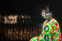 © Licensed to London News Pictures. 05/06/2013. London, England. Collection by Angus Chiang from Shih Chien University, Taiwan. International Show Award 2013. A model walks down the catwalk during the Gala Show at Earl's Court 2. Graduate Fashion Week 2013 showcasing student collections took place at Earl's Court II from 2 to 5 June 2013. Photo credit: Bettina Strenske/LNP