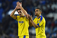 Will Nightingale (5) of AFC Wimbledon and Kwesi Appiah (9) of AFC Wimbledon applauds the travelling fans at full time after a 2-1 loss to Portsmouth during the EFL Sky Bet League 1 match between Portsmouth and AFC Wimbledon at Fratton Park, Portsmouth, England on 1 January 2019.