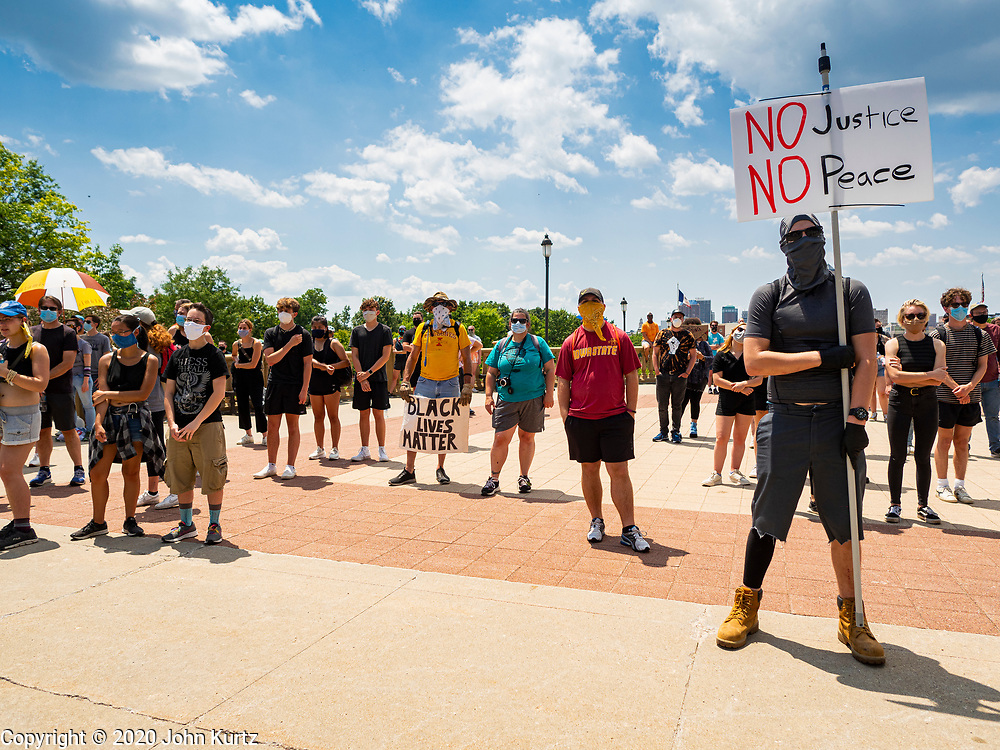 04 JULY 2020 - DES MOINES, IOWA: Protesters gather on the plaza in front of the Iowa State Capitol. Hundreds of people came to the grounds of the Iowa State Capitol to protest against and in favor of historic monuments on the capitol grounds. Several hundred people protested against a monument to Christopher Columbus and the stereotypical depiction of Native Americans on the capitol grounds. About 50 people came to the capitol to rally in support of the monuments. The protest against the monuments was organized by Seeding Sovereignty, a collective of indigenous women. The rally to defend the monuments was organized by an Iowa chapter of Three Percenters.   PHOTO BY JACK KURTZ