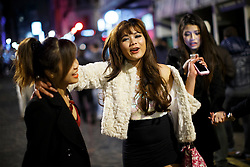 © licensed to London News Pictures. London, UK 01/01/2015. Revellers in central London celebrating the New Year at the first hours of 2015. Photo credit: Tolga Akmen/LNP