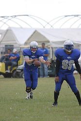 14 August 2004   Storms Pierre Myers offers protection for Punter Mike Wiggins. Twin City Storm V Capitol City Outlaws, Midwest Football League, Interstate Center, Bloomington-Normal IL