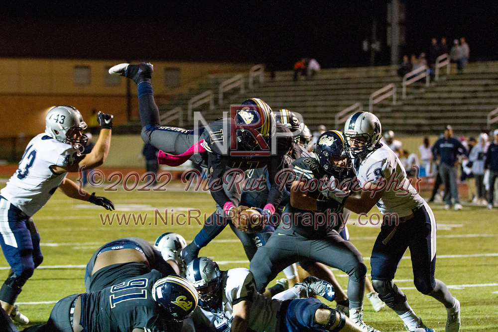 Southmoore's Jaedyn Scott gets a little airtime as he score a touchdown for the Sabercats during the game on, Friday, October 19, 2018, at Moore Stadium.