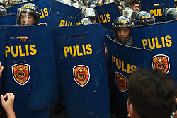 July 4, 2017 - Manila, Philippines - Anti-riot police stand their guard as protesters from different militant groups attempt to march towards the U.S. Embassy in Manila on Filipino - American friendship day, 04 July 2017. Protesters aired their sentiments and called for the end of US troops intervention in the Marawi conflict. (Credit Image: © George Calvelo/NurPhoto via ZUMA Press)