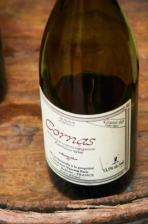 A bottle of Cornas Granit 60 Vieilles Vigne 2002 on top of a barrel. Vincent Paris, Cornas, Ardeche, Ardèche, France, Europe