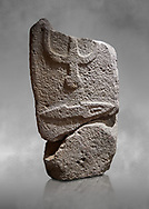 Central fragment of a Late European Neolithic prehistoric Menhir standing stone with carvings on its face side. The representation of a stylalised male figure would have started at the top with the remaons of  a carving of a falling figure with head at the bottom and 2 curved arms encircling a body above. at the bottom is a carving of a dagger running horizontally across the menhir.  Excavated from Piscina 'E Sali VI site,  Laconi. Menhir Museum, Museo della Statuaria Prehistorica in Sardegna, Museum of Prehoistoric Sardinian Statues, Palazzo Aymerich, Laconi, Sardinia, Italy .<br /> <br /> Visit our PREHISTORIC PLACES PHOTO COLLECTIONS for more photos to download or buy as prints https://funkystock.photoshelter.com/gallery-collection/Prehistoric-Neolithic-Sites-Art-Artefacts-Pictures-Photos/C0000tfxw63zrUT4