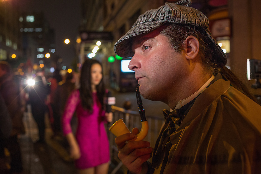 New York, NY, October 31, 2013. A man dressed as Sherlock Holmes, with deerstalker cap and full bent meerschaum pipe, in the Greenwich Village Halloween Parade.