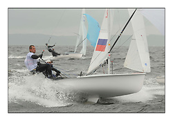 470 Class European Championships Largs - Day 2.Wet and Windy Racing in grey conditions on the Clyde...RUS2, Mikhail SHEREMETYEV, Maxim SHEREMETYEV, St. Petersburg..
