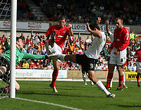 Photo: Rich Eaton.<br /> <br /> Wrexham v Hereford United. Coca Cola League 2. 24/09/2006. Tim Sills of Hereford in centre sees his shot stopped by Mike Ingham, Wrexham goalkeeper