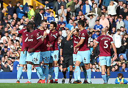 West Ham United's Andriy Yarmolenko (second left) celebrates scoring his side's second goal of the game with team mates during the Premier League match at Goodison Park, Liverpool.