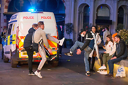 Licensed to London News Pictures. 10/10/2020. London, UK. Revellers dancing with blaring sound system at Leicester Square, central London. After the 10pm curfew early closing of pubs and bars. Photo credit: Marcin Nowak/LNP