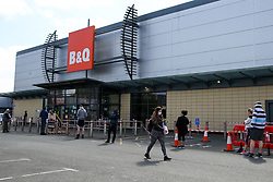 © Licensed to London News Pictures. 25/04/2020. London, UK. Shoppers queue outside B&Q, a DIY chain store in Tottenham Hale Retail Park, north London during the coronavirus lockdown. The lockdown continues to slow the spread of COVID-19 and reduce pressure on the NHS. Photo credit: Dinendra Haria/LNP