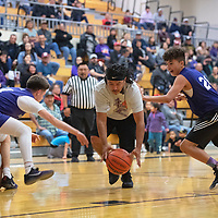 Eric Silva, center, chases down a loose ball for Patriot Alumni during the second annual Miyamura Alumni basketball game Wednesday night at Miyamura High School in Gallup.
