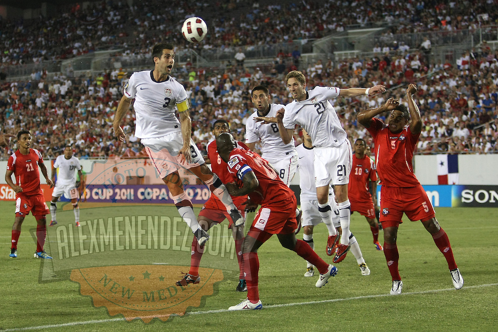 USA defender Carlos Bocanegra (3) heads the ball during a CONCACAF Gold Cup soccer match between the United States and Panama on Saturday, June 11, 2011, at Raymond James Stadium in Tampa, Fla. (AP Photo/Alex Menendez)