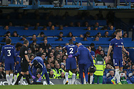 Antonio Rudiger of Chelsea limps off the field after a tackle holding his back.<br /> Premier league match, Chelsea v Stoke city at Stamford Bridge in London on Saturday 30th December 2017.<br /> pic by Kieran Clarke, Andrew Orchard sports photography.