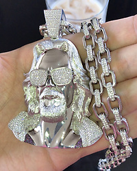 """John Mayer releases a photo on Instagram with the following caption: """"If you\u2019re asking me if I had @benballer make me a diamond encrusted chain bearing a likeness of The Dude for my 40th birthday, then I guess my answer would have to be you\u2019re damn right I did. \nAnxiety and worry is canceled this week. \u26a1\ufe0f\u2665\ufe0f\u26a1\ufe0f"""". Photo Credit: Instagram *** No USA Distribution *** For Editorial Use Only *** Not to be Published in Books or Photo Books ***  Please note: Fees charged by the agency are for the agency's services only, and do not, nor are they intended to, convey to the user any ownership of Copyright or License in the material. The agency does not claim any ownership including but not limited to Copyright or License in the attached material. By publishing this material you expressly agree to indemnify and to hold the agency and its directors, shareholders and employees harmless from any loss, claims, damages, demands, expenses (including legal fees), or any causes of action or allegation against the agency arising out of or connected in any way with publication of the material."""