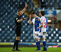 Referee Robert Jones shows Blackburn Rovers' Joseph Rankin-Costello a yellow card for dissent <br /> <br /> Photographer Alex Dodd/CameraSport<br /> <br /> The EFL Sky Bet Championship - Blackburn Rovers v Swansea City - Tuesday 9th March 2021 - Ewood Park - Blackburn<br /> <br /> World Copyright © 2021 CameraSport. All rights reserved. 43 Linden Ave. Countesthorpe. Leicester. England. LE8 5PG - Tel: +44 (0) 116 277 4147 - admin@camerasport.com - www.camerasport.com