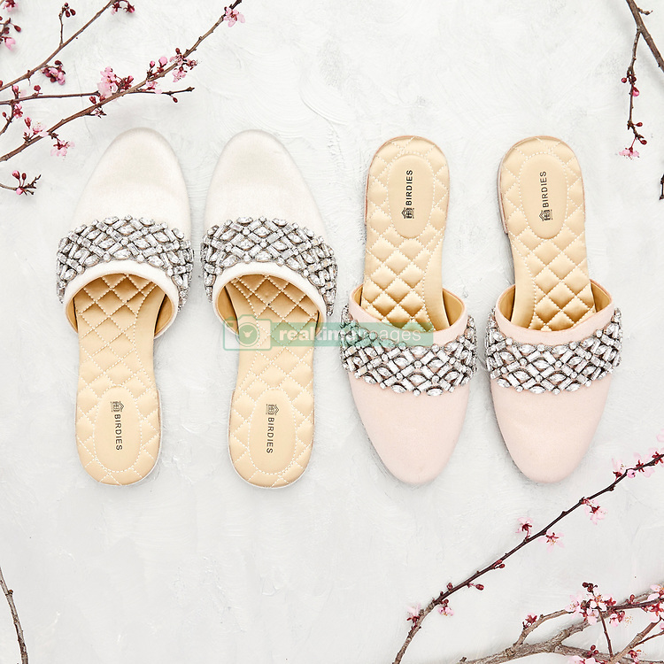 New parents the Duke and Duchess of Sussex will celebrate their first wedding anniversary on May 19. And as timing has it, Harry could have the perfect gift for Meghan as her favorite shoe-slipper brand have just released a new collection. Birdies — a brand that makes stylish flats that secretly double-up as slippers has released a new bridal collection in Nordstrom. There are three styles available in both champagne and blush, detailed with crystal embellishments, velvet, and fringe. Meghan was recently spotted wearing a pair of velvet Birdies — a $120 pair of the Starling Flats in black — during her Moroccan tour with Prince Harry back in February. Before that she had worn the same shoes while strolling through the Redwood Treewalk Rotorua during her royal tour in Australia in October last year (2018). Clearly the comfortable flats — which boast super-cushioned soles and quilted lining — were a go-to for then-pregnant Duchess. But Meghan has been a fan of Birdies for years, and back in the day often posted photos of herself wearing them on her now-deleted Instagram account. She was also seen wearing them around Toronto when she first started dating Harry. 14 May 2019 Pictured: Meghan Markle's favorite shoe-slipper brand Birdies has just released a new Bridal Collection in May, 2019. Photo credit: Birdies/ MEGA TheMegaAgency.com +1 888 505 6342