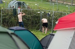 © Licensed to London News Pictures. 05/09/2014. Isle of Wight, UK. Festival goers at Bestival 2014 Day 2 Friday wash themselves in the campsite.  This weekend's headliners include Chic featuring Nile Rodgers, Foals and Outcast Photo credit : Richard Isaac/LNP