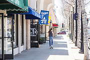 Girl Walking through Downey Ave Downey California