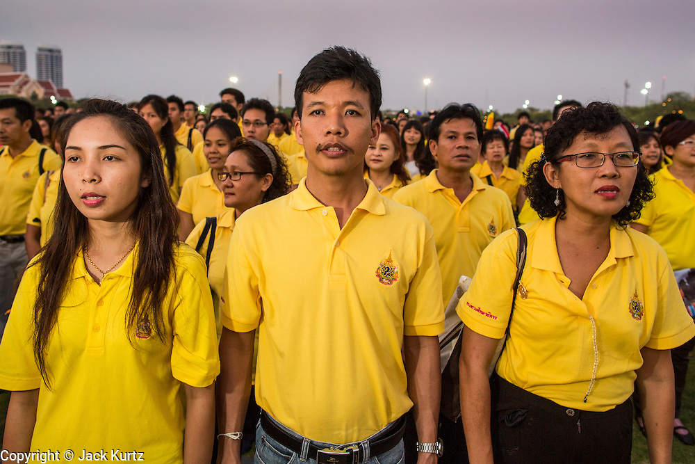 05 DECEMBER 2012 - BANGKOK, THAILAND:  Thais sing the King's Anthem during the public ceremony to celebrate the birthday of Bhumibol Adulyadej, the King of Thailand, on Sanam Luang, a vast public space in front of the Grand Palace in Bangkok Wednesday night. The King celebrated his 85th birthday Wednesday and hundreds of thousands of Thais attended the day long celebration around the Grand Palace and the Royal Plaza, north of the Palace. The Thai monarch is revered by most Thais as unifying force in Thailand's society, which is not yet recovered from the political violence of 2010.     PHOTO BY JACK KURTZ