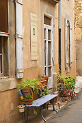 Domaine Entretan, J-C and D Plantade in Roubia. Minervois. Languedoc. The main building. A bench and flower pots. France. Europe.