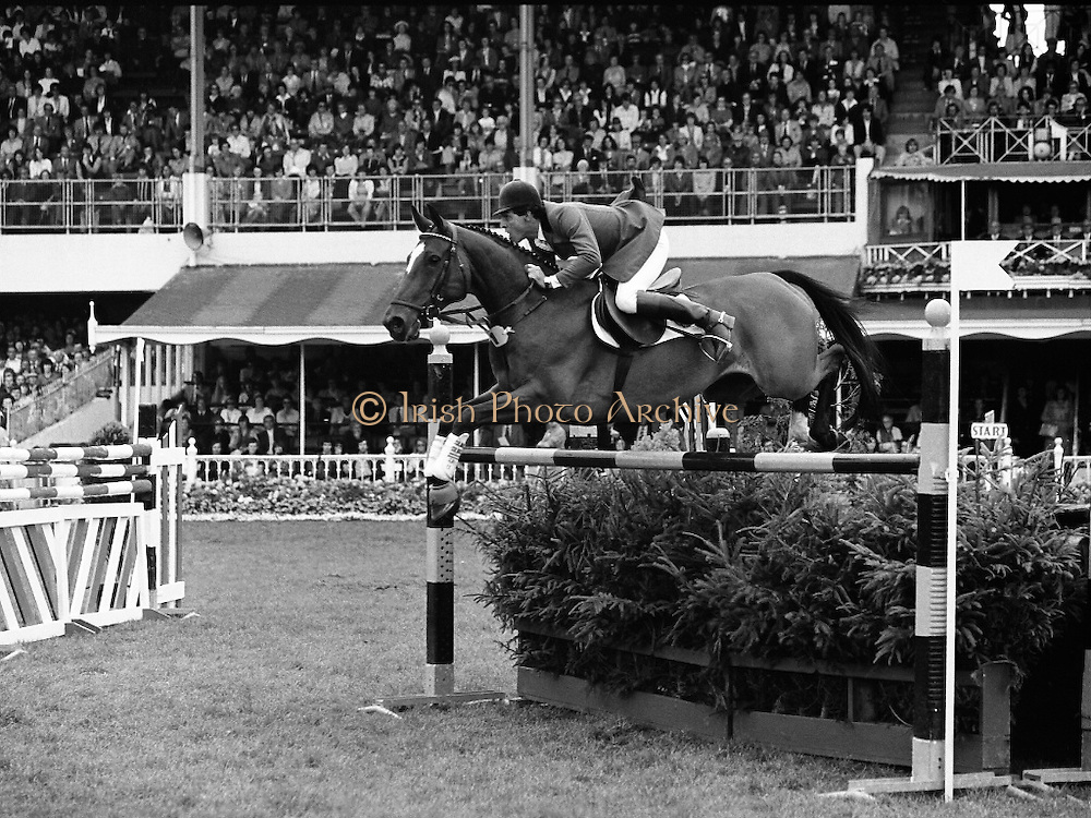 Aga Khan Trophy..1979..10.08.1979..08.10.1979..10th August 1979..The annual staging of the Aga Khan Cup took place  at the Royal Dublin Showgrounds, Ballsbridge,Dublin today.It was the first time since 1937 that Ireland won the trophy outright. The winning Irish team comprised of Paul Darragh,Capt Con Power,James Kernan and Eddie Macken..An action picture shows the concentration of both horse and rider as they clear one of the fences.
