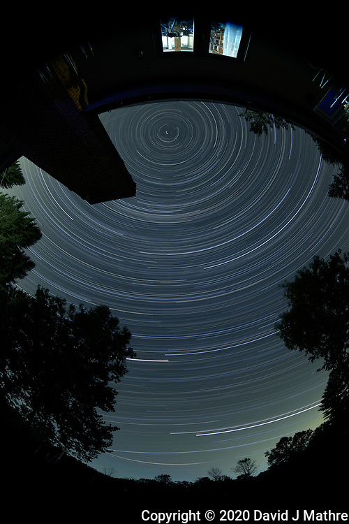 Star Trails looking Up from my backyard patio. Composite of  172 images taken with a Nikon D810a camera and 8-15 mm fisheye lens (ISO 200, 11 mm, f/4, 120 seconds). JPG images processed with PhotoShop CC (scripts, statistics, maximum).