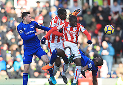 Everton's Yannick Bolasie (right) battles for the ball with Stoke City's Badou Ndiaye, Stoke City's Kurt Zouma and Everton's Michael Keane during the Premier League match at the bet365 Stadium, Stoke.
