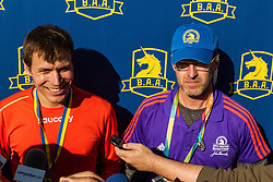 Boston Marathon: BAA 5K road race, Ben True after setting new American Record for 5k road, with previous record-holder Marc Davis next to him