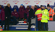 Manchester City Manager Pep Guardiola looks over as stewards stop a Leicester city fan who taunts him as he invades the pitch .Carabao Cup quarter final match, Leicester City v Manchester City at the King Power Stadium in Leicester, Leicestershire on Tuesday 19th December 2017.<br /> pic by Bradley Collyer, Andrew Orchard sports photography.
