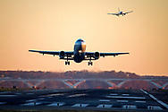 Nov 21, 2017; Washington, DC, USA; An airliner takes off as another one comes in for landing at Ronald Reagan International Airport. Mandatory Credit: Peter J. Casey