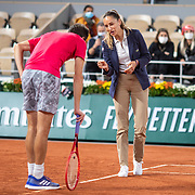 PARIS, FRANCE September 29.  Gilles Simon of France argues a line call with umpire Marijana Veljovic during his match with Denis Shapovalov of Canada in the first round of the singles competition on Court Philippe-Chatrier during the French Open Tennis Tournament at Roland Garros on September 29th 2020 in Paris, France. (Photo by Tim Clayton/Corbis via Getty Images)