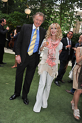 RICHARD & BASIA BRIGGS at a garden party hosted by Piaget at The Hempel Hotel, London on 14th July 2011.