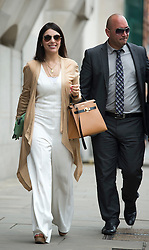 © London News Pictures. 21/08/2012. London, UK.  Nur Nadir (left) , wife of Cypriot businessman Asil Nadir, arriving at The Old Bailey in London accompanied by her security on August 21, 2012 where her husband is currently waiting for a jury to return a verdict on nine charges in the Polly Peck fraud case. The Old Bailey jury found Nadir, 71, guilty yesterday (Mon) of three counts of theft amounting to a total of more than £5.5 million.. Photo credit : Ben Cawthra/LNP