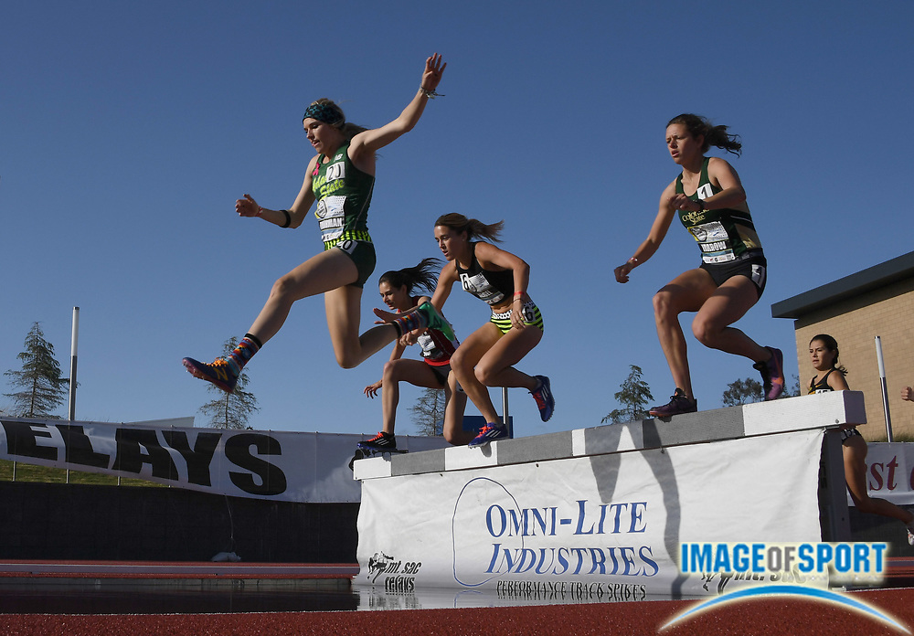 Apr 13, 2017; Torrance, CA, USA; Jenna Thurman (Adams State), Emma Neigel (Denver Track Club) and Laura Yarrow (Colorado State) race over the water jump in a women's steeplechase heat during the 59th Mt. San Antonio College Relays at El Camino College.