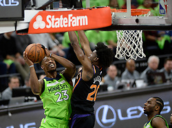 December 16, 2017 - Minneapolis, MN, USA - The Minnesota Timberwolves' Jimmy Butler (23) powers past the defense of the Phoenix Suns' Josh Jackson (20) for a layup in the first quarter on Saturday, Dec. 16, 2017, at Target Center in Minneapolis. (Credit Image: © Aaron Lavinsky/TNS via ZUMA Wire)