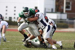 10 November 2007: Nick Theobald gets his hooks around ball carrier Jon Mecham. This game between the Wheaton College Thunder and the Illinois Wesleyan University Titans was for a share of the CCIW Championship and was played at Wilder Field on the campus of Illinois Wesleyan University in Bloomington Illinois.