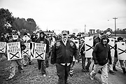 """10282017 - Shelbyville, Tennessee, USA: Participants walk to the site of a """"White Lives Matter"""" rally in downtown Shelbyville, Tennessee. The rally, and the counter rally were the largest such gatherings since the deadly Charlottesville Unite the Right rally in August. Police created two areas for protesters, and kept the groups apart. A coalition of neo-Nazis and white nationalists  including the Nationalist Socialist Movement, Traditional Workers Party, Vanguard America and Anti-Communist Action, and League of the South, were present. A second rally in Murfreesboro was canceled, and the groups gathered at Henry Horton State Park, but dispersed when members of the media arrived."""