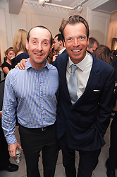 Left to right, chef MARK ASKEW and JOEL CADBURY at a party to celebrate the launch of Page One an online guide to London's 100 most rewarding restaurants held at the Halcyon Gallery, Bruton Street, London on 7th July 2010.