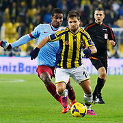 Fenerbahce's Diego Ribas (R) and Trabzonspor's Kevin Constant (L) during their Turkish superleague soccer derby Fenerbahce between Trabzonspor at the Sukru Saracaoglu stadium in Istanbul Turkey on Saturday 07 February 2015. Photo by Aykut AKICI/TURKPIX