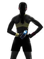 one woman exercising fitness holding energy drink rear view in silhouette on white background