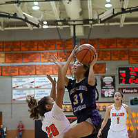 On Tuesday night, Tiajhae Nez (31) of Kirtland Central drives to the basket as Kamryn Yazzie (20) of Gallup tries to defend the baseline in Gallup. Kirtland Central won 62-53.