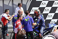 Ducati's Team rider Italian Andrea Dovizioso (C), winner, Movistar Yamaha's Spanish rider Maverick Vinales (L), second, and OCTO Pramac Yakhnich's Italian rider Danilo Petrucci, third, celebrate on the podium after winning the Moto GP Grand Prix at the Mugello race track on June 4, 2017. Ducati's Andrea Dovizioso thrilled the home crowds with a stirring MotoGP victory at Mugello on Sunday that saw him edge championship leader Maverick Vinales. Another Italian, Danilo Petrucci, was third while veteran superstar Valentino Rossi of Yamaha won plaudits for racing in pain from a training accident and finishing fourth having set the early pace.<br /> Photo by Danilo D'Auria.<br /> <br /> Danilo D'Auria/UK Sports Pics Ltd/Alterphotos