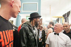 © London News Pictures. 20/09/2012. David Haye - former WBA heavyweight champion talks to the referee for the Rumble in the Kitchen charity boxing event at The Royal Automobile Club in London. Chefs participating in the Rumble in the Kitchen charity event Galvins Chance, help the charity support young people aged 18-24 who may be ex-offenders or who are deemed disadvantaged, including those at risk of gang culture to find employment in the hospitality undustry.. Picture credit should read Manu Palomeque/LNP