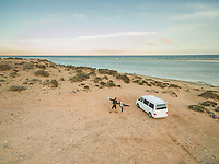 Aerial view of a Family and their travelling van on the Sotavento beach in fuerteventura, Canary Islands.